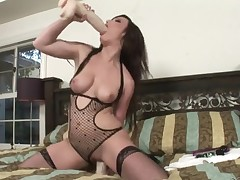 Naughty Jennifer White in nylons and stiletto shoes toy fucks her wet cunt on the bed with her thong panties on. Nothing can stop hot angel from drilling her slit with a dildo.