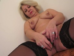 Sexy grandma playing with her twat