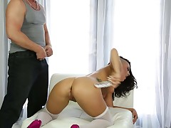 Inked slut Rachael Madori in white stockings and pink high heels shakes her sexy booty in front of Eric Masterson. Then she gets her throat attacked by his rock hard cock. She gags on his pole eagerly
