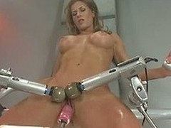 Big racked sporty brunette Ariel X is naked and enjoys crazy sex with fucking machines. She gets her her vagina dildoed and her clit double vibrated before she takes heavy fake cock in all directions her ass.