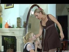 Blond maid in lacklustre stockings gags on a strap-on coupled with takes it up her snatch