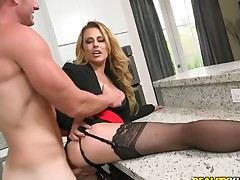 Blonde woman with giant tits and bald muff is good on her way to make hard cocked guy explode on oral action