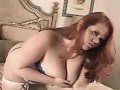 Massive redhead gal in a corset Mora from 1fuckdatecom