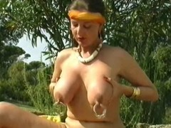 German girl plays with her large pierced nipps