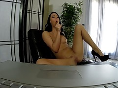 Brunette Sabrina Banks has fire in her eyes as she fingers her cum-hole