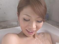 Cute Oriental angel fingers her hairy muff in the bathtub
