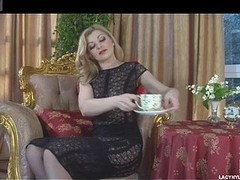 Blond temptress peels off her red wrapping and puts on fashionable malignant nylons