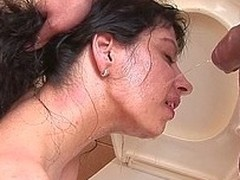 Horny pissing slut kinked take on the toilet