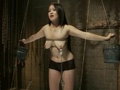 Finite Asian girl with big boobs gives a blowjob