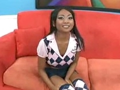 Beautiful young Asian dressed as schoolgirl