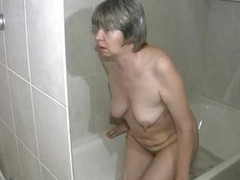 Yeah, this venerable bitch washes her saggy jugs and belly. She`s a dirty venerable slut that needs to wash her pussy really hard. Look at her how slow she gets in that take a shower tub. Keep in view out bitch, don`t break a hip or something. Let`s see h