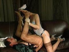 Messy nurse thoroughly inspecting guy