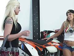 Bossy blonde Leya Falcon in black minidress and nylons gets her nice pussy tongue fucked by pretty Carmen Caliente. Hot gal licks her snatch on her knees without taking a break
